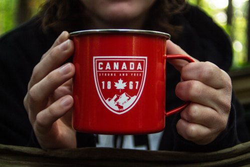 Canada 1867 mug held by two hands