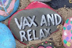 """""""vax and relax"""" on a painted rock"""